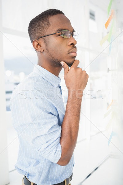 Serious businessman thinking with hand on chin Stock photo © wavebreak_media