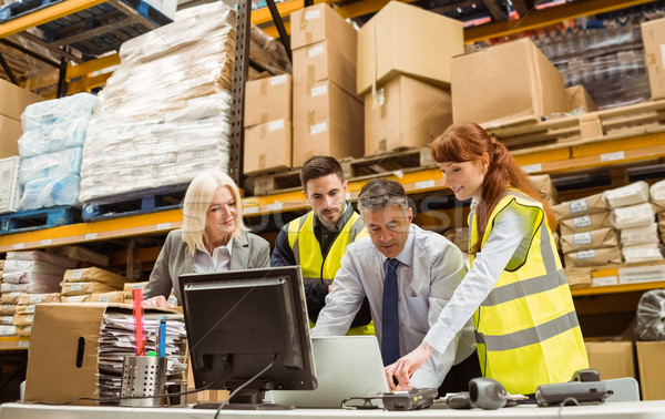 Warehouse managers and worker working on laptop Stock photo © wavebreak_media