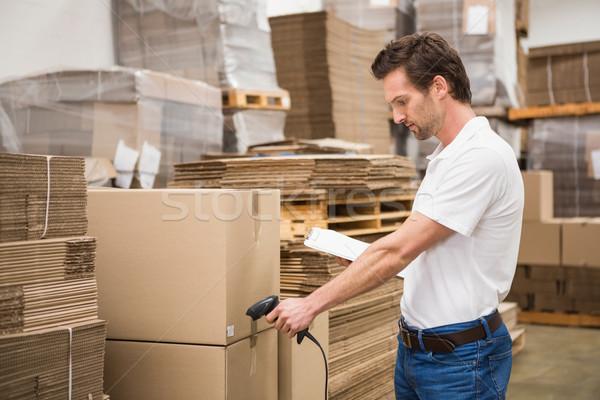 Trabajador paquete almacén manual de trabajo Trabajo Foto stock © wavebreak_media