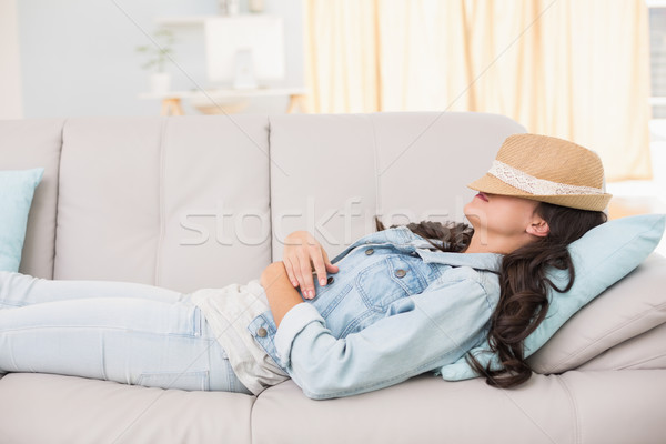 Stock photo: Pretty brunette relaxing on the couch