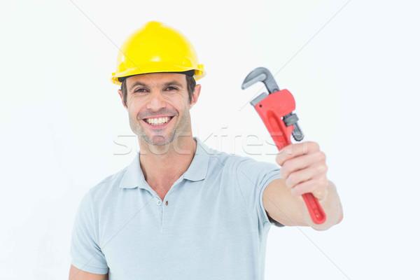 Happy handyman holding monkey wrench Stock photo © wavebreak_media