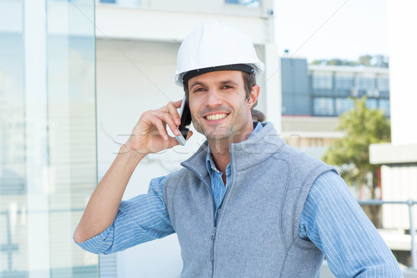 Smiling male architect using mobile phone outdoors Stock photo © wavebreak_media