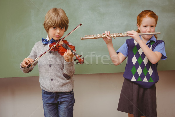 Students playing flute and violin in classroom Stock photo © wavebreak_media