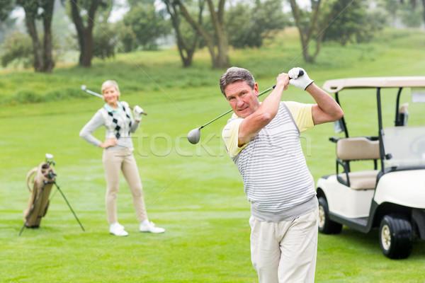 Golfista socio detrás brumoso día Foto stock © wavebreak_media