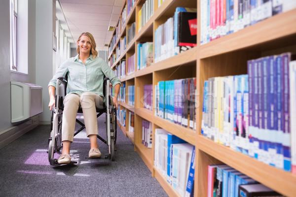 улыбаясь инвалидов студент библиотека университета женщину Сток-фото © wavebreak_media