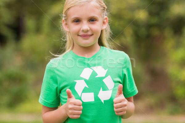 Happy little girl in green with thumbs up  Stock photo © wavebreak_media