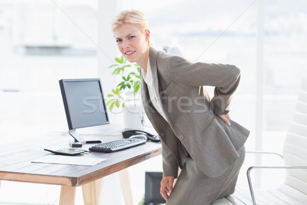 Triste mujer de negocios dolor de espalda oficina ordenador mujer Foto stock © wavebreak_media