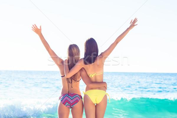 Happy friends having fun beside the water Stock photo © wavebreak_media