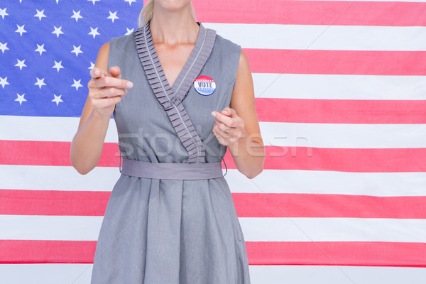 Femme blonde drapeau américain badge blanche femme Photo stock © wavebreak_media