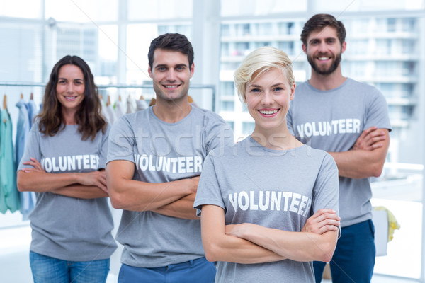 Happy volunteers friends smiling to the camera Stock photo © wavebreak_media