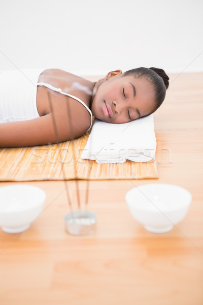 Peaceful pretty woman lying a bamboo mat  Stock photo © wavebreak_media