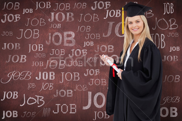 Composite image of blonde student in graduate robe holding a dip Stock photo © wavebreak_media