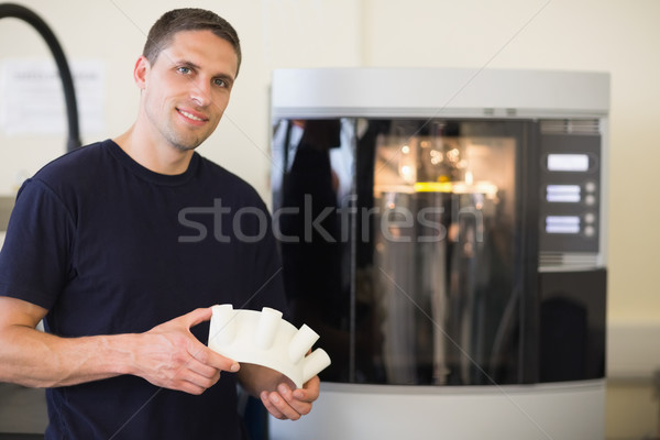Engineering student holding object printed from 3d printer Stock photo © wavebreak_media