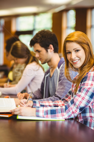 Diák néz kamera tanul osztálytársak könyvtár Stock fotó © wavebreak_media