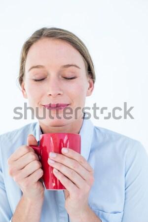 Businesswoman smelling her coffee  Stock photo © wavebreak_media