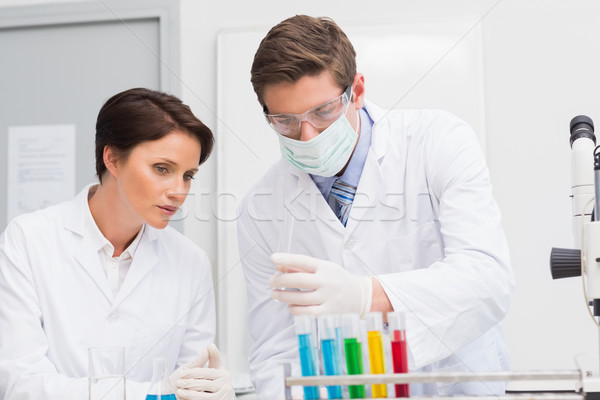 Scientists looking attentively at test tube Stock photo © wavebreak_media