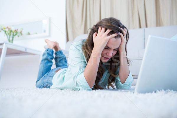 Endişeli kadın dizüstü bilgisayar kullanıyorsanız ev oturma odası bilgisayar Stok fotoğraf © wavebreak_media