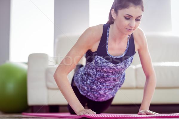 Uygun kadın basın yukarı egzersiz ev Stok fotoğraf © wavebreak_media