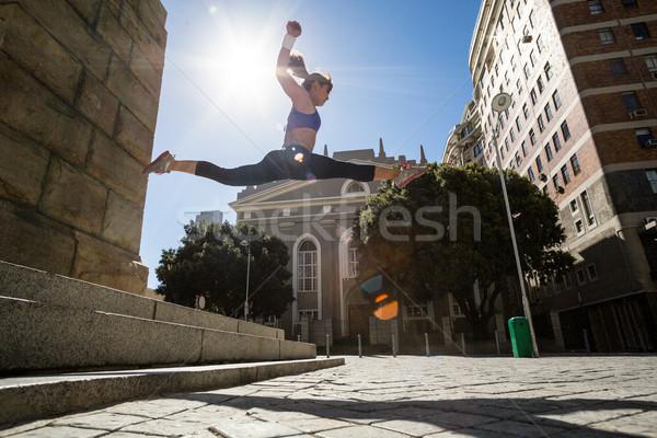 Sportos nő ugrik el lépcsősor levegő Stock fotó © wavebreak_media