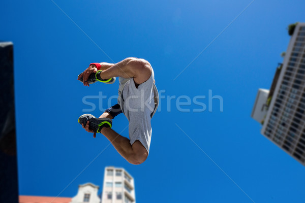 Extreme athlete jumping in the air in front of a building Stock photo © wavebreak_media