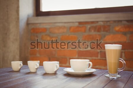 несколько горячей напитки деревянный стол кофейня Сток-фото © wavebreak_media