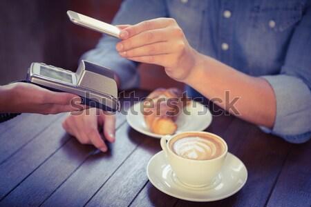 Male customer paying with smartphone Stock photo © wavebreak_media