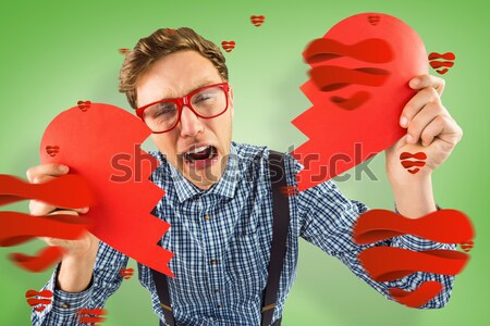 Crying man holding broken heart Stock photo © wavebreak_media