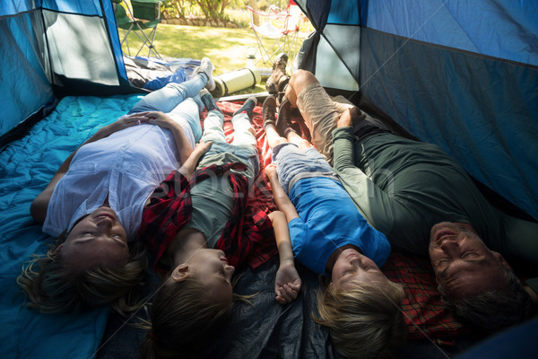 Stock photo: Family lying in the tent