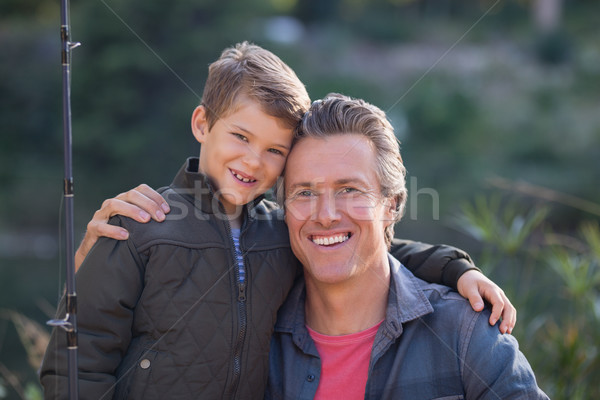 Portrait of happy father and son with fishing rod  Stock photo © wavebreak_media