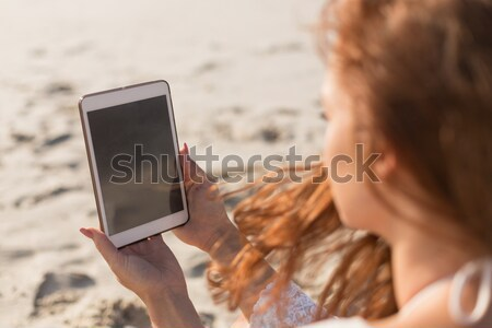Stock photo: High angle view of man using digital tablet at beach