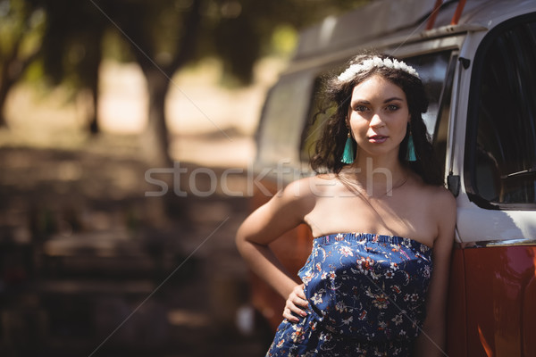 Portrait of young woman standing by motor home Stock photo © wavebreak_media