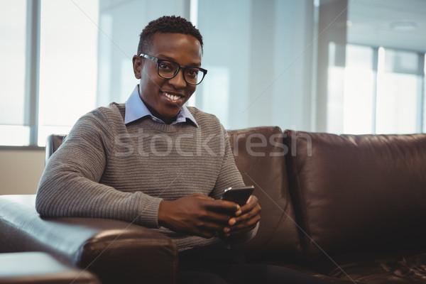 Male executive using mobile phone in office Stock photo © wavebreak_media