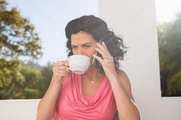питьевой кофе говорить мобильного телефона кафе Сток-фото © wavebreak_media