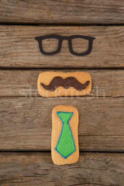 Cookies moustache cravate forme table vue Photo stock © wavebreak_media