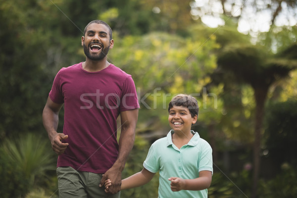 Cheerful father and son holding hands at park Stock photo © wavebreak_media