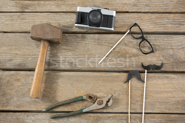 Overhead view of camera with work tools on table Stock photo © wavebreak_media