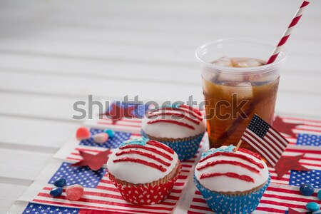 Decorated cupcake and cold drink with 4th july theme Stock photo © wavebreak_media