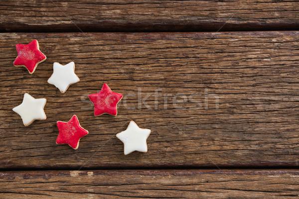 Kırmızı beyaz şeker kurabiye ahşap masa Stok fotoğraf © wavebreak_media