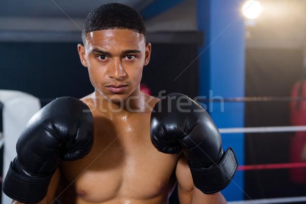 Portrait of male boxer wearing black gloves Stock photo © wavebreak_media