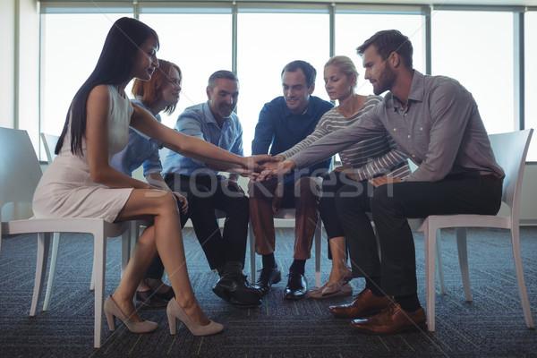 бизнеса коллеги рук служба сидят стульев Сток-фото © wavebreak_media