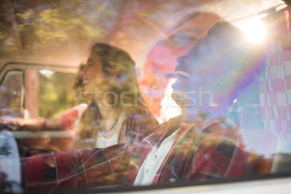 Cheerful friends seen through glass Stock photo © wavebreak_media