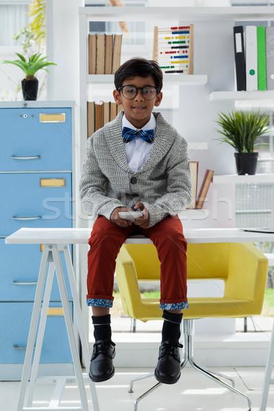 Teljes alakos portré üzletember tart okostelefon ül Stock fotó © wavebreak_media