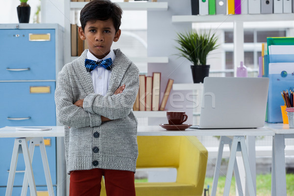 Portrait of boy pretending as businessman standing with arms crossed Stock photo © wavebreak_media