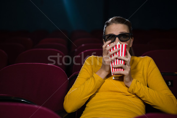Woman scared while watching movie in theatre Stock photo © wavebreak_media