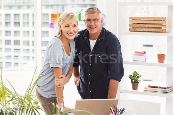 Sorridere squadra di affari guardando fotocamera ritratto lavoro Foto d'archivio © wavebreak_media