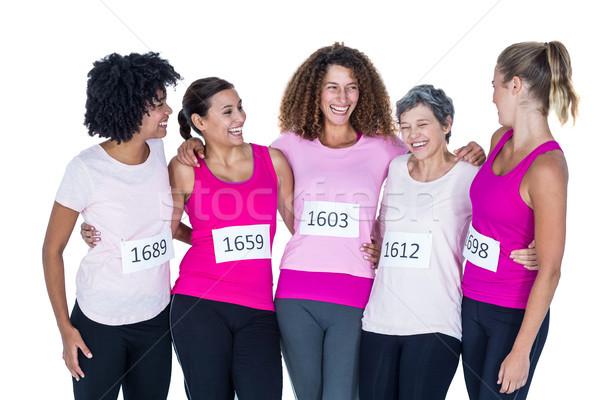 Smiling athletes with arms around  Stock photo © wavebreak_media