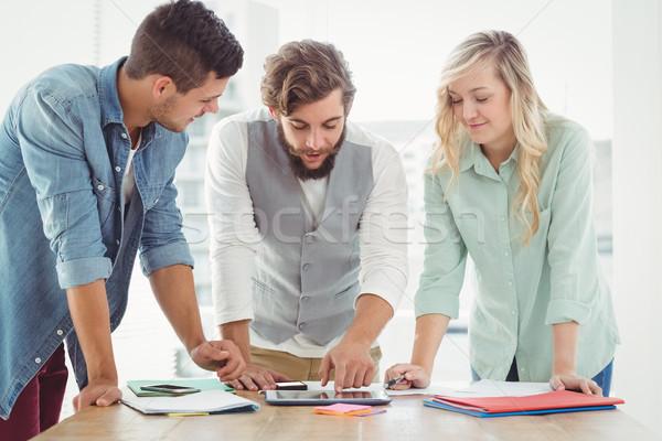 Business professionals working on digital tablet  Stock photo © wavebreak_media
