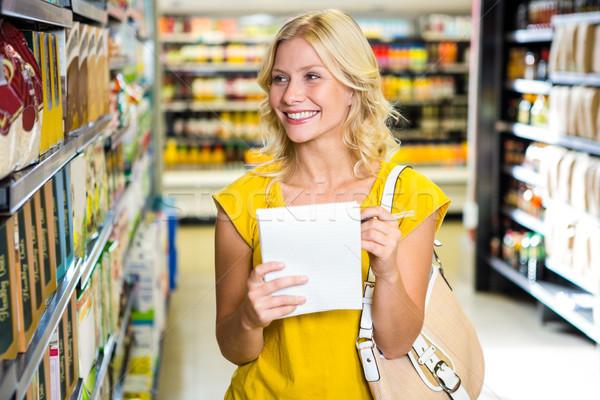 Glimlachend blond vrouw lijst supermarkt business Stockfoto © wavebreak_media