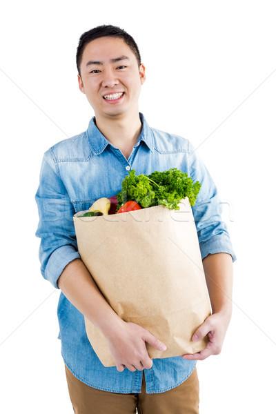Retrato hombre comestibles bolsa blanco alimentos Foto stock © wavebreak_media