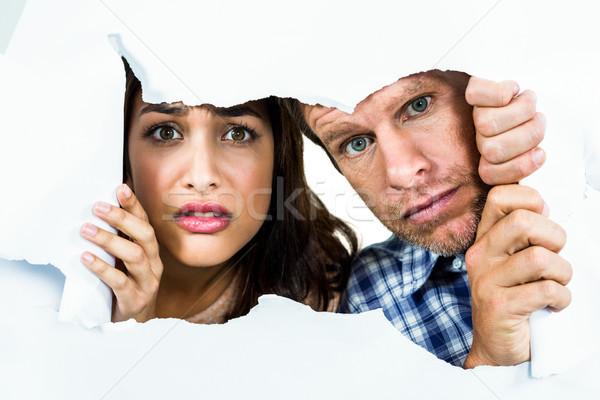 Portrait couple papier déchiré papier homme Homme Photo stock © wavebreak_media